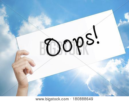 Oops! Sign On White Paper. Man Hand Holding Paper With Text. Isolated On Sky Background