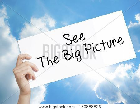 See The Big Picture Sign On White Paper. Man Hand Holding Paper With Text. Isolated On Sky Backgroun