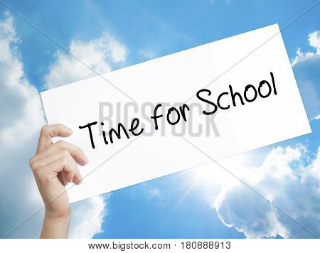 Time for School Sign on white paper. Man Hand Holding Paper with text. Isolated on sky background. Business concept. Stock Photo