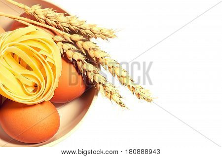 Chicken Eggs With Wheat Spikelets And Pasta Isolated Toned