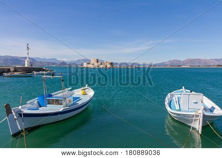 Traditional Fishing Boats, Lightouse And Bourtzi Fortress In Nafplion, Greece