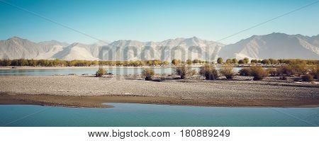 Beautiful lake and mountain scenery in Tibet .