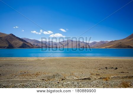 Beautiful blue color lake and mountain scenery in Tibet .