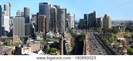 Sydney City Panorama and traffic entering Sydney Harbour Bridge