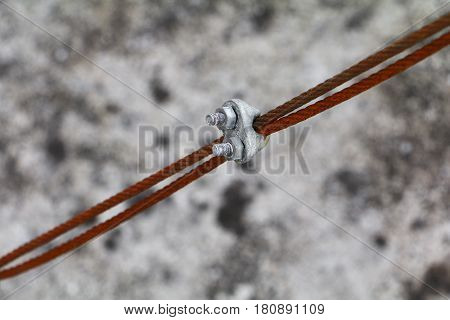 wire rope clip old connection of sling cable select focus with shallow depth of field.