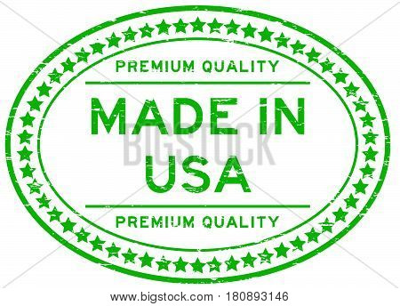 Grunge green premium quality made in USA oval rubber seal stamp on white background