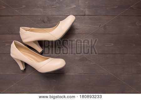 High Heels Are On Wooden Background With Copy Space