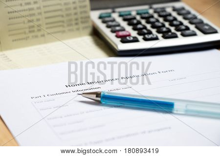 Blank home insurance application wait for filling with passbook and calculator background