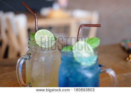Refreshing summer homemade cocktail on wood table