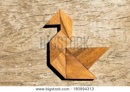 Wooden tangram puzzle in swan shape background