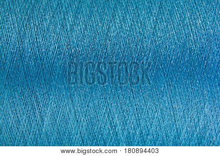 Closed up of blue color thread texture background