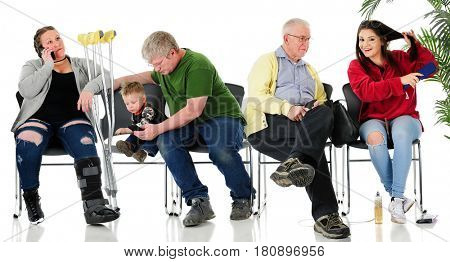 3 adults, a teen, and a toddler in waiting room chairs. May be a doctor's office at the License Bureau, a welfare office, or other public waiting area.  On a white background.