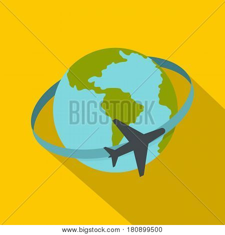 Travelling by plane around the world icon. Flat illustration of travelling by plane around the world vector icon for web