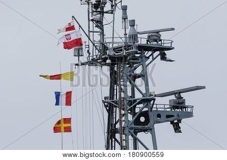 BALTIC SEA / POLAND - 2017: Signal flags and flag on the mast of the Polish warship
