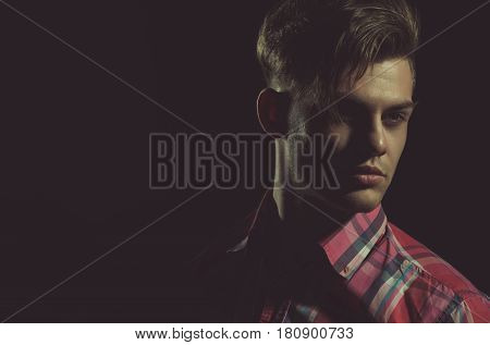 Handsome Man Posing With Serious Face In Red Plaid Tshirt