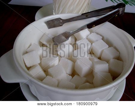Sugar cubes A bowl filled with white sugar cubes
