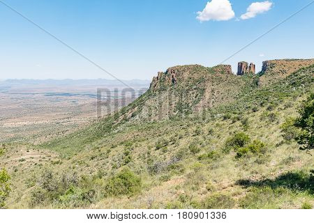 View of dolerite columns with the Valley of Desolation below as seen from the road to viewpoint next to the columns near Graaff Reinet
