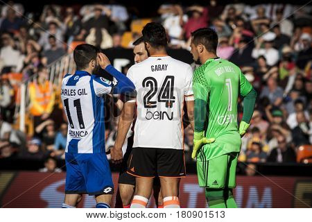 VALENCIA, SPAIN - APRIL 2: Players talking with referee during La Liga match between Valencia CF and Deportivo at Mestalla Stadium on April 2, 2017 in Valencia, Spain