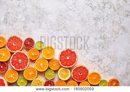 Citrus fruits juicy vitamin mix flat lay, blank empty design space healthy vegetarian organic food, antioxidant detox diet. Tropical summer mix grapefruit, orange, apple, sliced kiwi fruit, lime