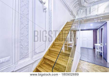 Classic interior design duplex apartment with white wall and ceiling moldings.Design of stairs.