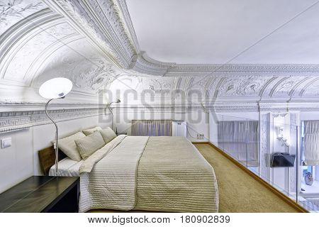 Classic interior design duplex apartment with white wall and ceiling moldings.Interior design bedrooms.