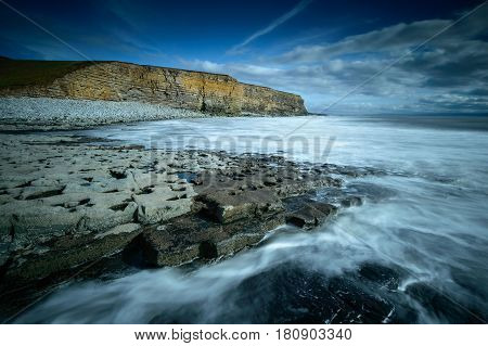 Rocks in front of the cliffs at Nash Point Wales