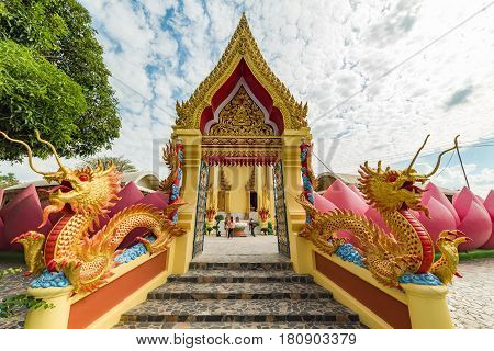 Colorful Buddhist Temple Entrance With Dragons, Lotus Flower And Golden Decoration
