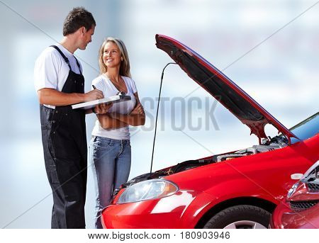 Car mechanic with client woman.