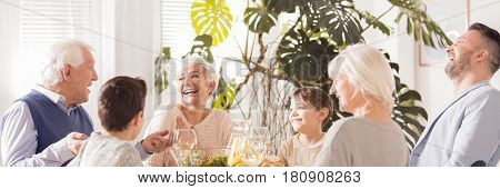 Laughing Family Eating Dinner
