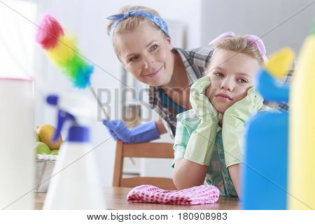 Sad Girl And Her Mom Cleaning