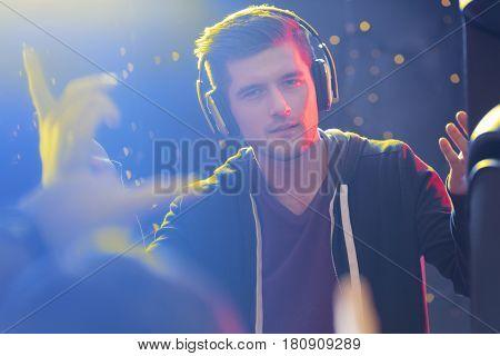 Charismatic Dj Wearing Headphones