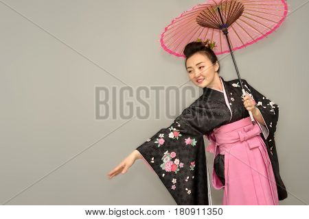 Beautiful Geisha In Traditional Japanese Kimono With Parasol