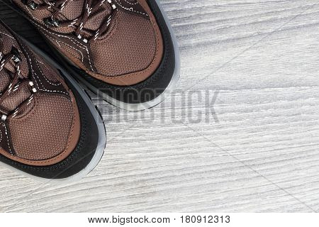 New Trekking Shoes On Wooden Background