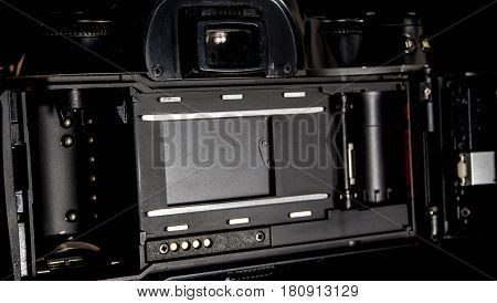 Back view of film system SLR camera body opened back lid to film position Inside view of the shutter