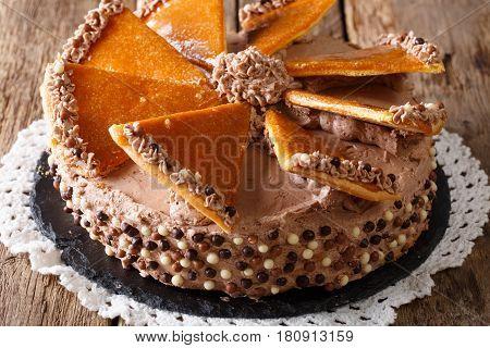 Tasty Hungarian Dobosh Torte With Caramel Decoration Close-up. Horizontal