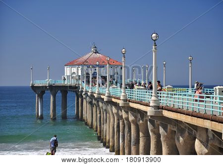 September 30 2016. Manhattan Beach Pier California. People walking on the manhattan beach pier in Manhattan Beach California on the pacific ocean.