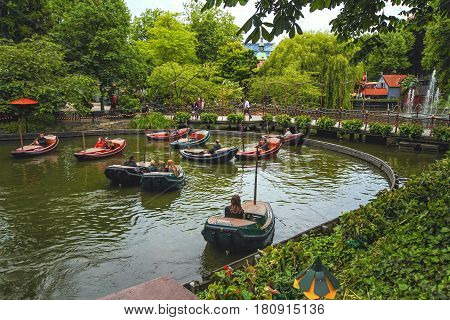 COPENHAGEN DENMARK - JUNE 15: Evening view of Tivoli Gardens with Dragon Boat lake in 2012