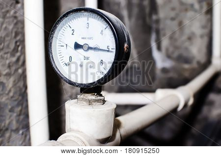 Old pressure measuring device manometer at the pump station