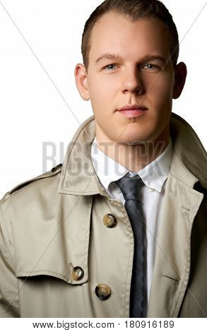fashion young man with trenchcoat - split lighting. Can be used as detective or superintendent concept