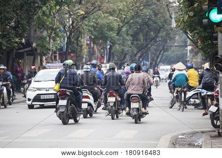Hanoi, Vietnam - March 9, 2017: Busy motorbike traffic in the Old Quarter in Hanoi. In recent decades, motorbikes have overtaken bicycles as the main form of transportation causing frequent gridlocks.