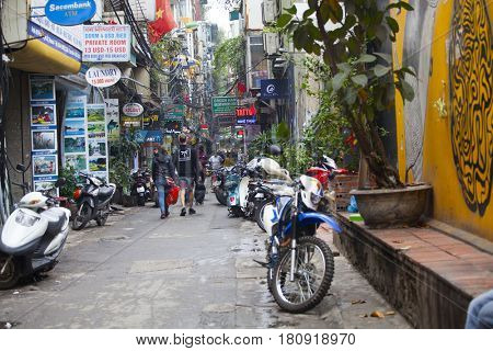 Hanoi, Vietnam - March 9, 2017: Busy street life in the Old Quarter in Hanoi - the capital city of Vietnam