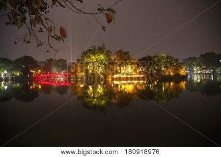 Hanoi, Vietnam - March 9, 2017: Hoan Kiem lake view at twilight with Ngoc Son old temple and The Huc bridge. Hoan Kiem lake (Sword lake or Ho Guom) is center of Hanoi