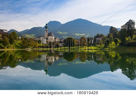 Reflection on the lake in Reith im Alpbachtal in Tyrol Austria