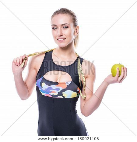Slim And Healthy Young Woman Wearing Sportswear Tracksuit Holding Measure Tape And Green Apple Isola