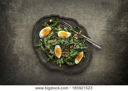 Fresh dandelion salad with eggs and beans overhead shoot