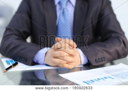 Businessman rubbing his hands together in office