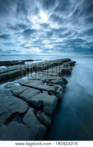 A protruding rock shelf at Nash Point on the Glamorgan Coast Wales