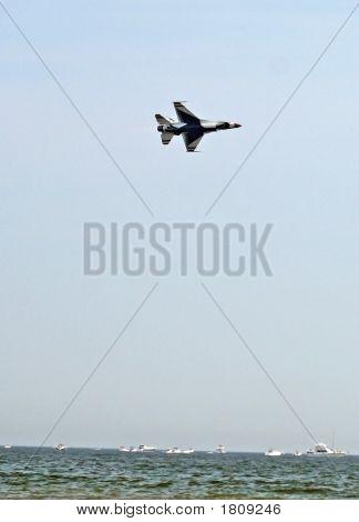 Single Air Force Thunderbird Over The Ocean