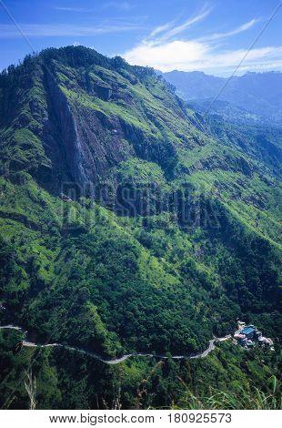 Mountain landscape with a winding road below. Sri Lanka.