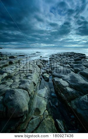 A channel in between the rocks leading to the sea at Nash Point on the Glamorgan Coast Wales